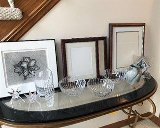 Baccarat vase, artwork, frames and crystal bowls, candle holders, and signed pottery vase