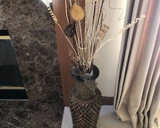 Large brass urn with dried floral