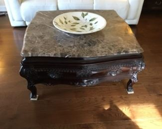 Marble top coffee table. $200.00