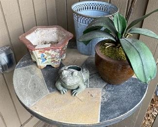 Outdoor table - $20; lanterns as follows - frog $6, artificial plant $5, basket look planter $7, ceramic flowered $6