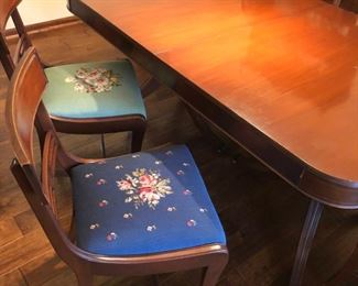 Set of 6 dining room chairs with needlepoint seats, Duncan Phyfe-style table with 2 leaves and pads