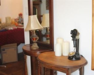 Small hall/tree table and barley twist table. Antique telephone and flickering candles.