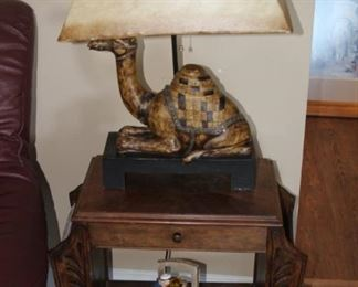 Antique end table with mosaic camel table lamp.