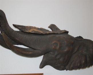 Wooden elephant sculpture.