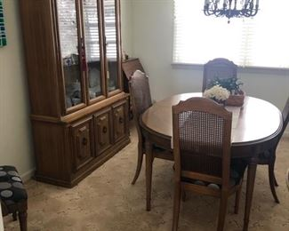 Very nice dining table with 6 chairs and breakfront
