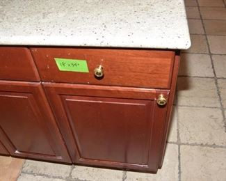 $1,400 to include: cabinets custom built by IXL cabinets, island, counters, sink, faucet