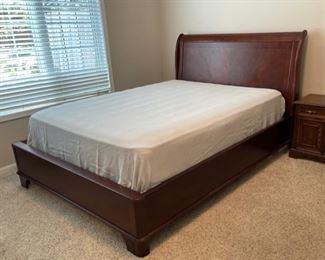 $300.00................ Queen Sleigh Bed *mattress and box spring not included (C157)