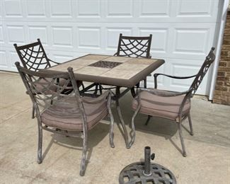 $100.00...................Sturdy Patio Table, 4 Chairs and Umbrella Stand (C001)