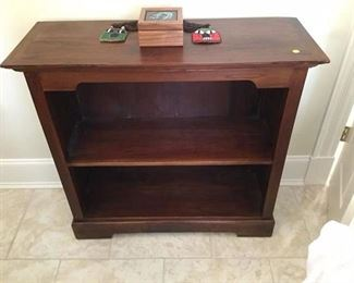 ONE OF THREE MAHOGANY BOOKCASES  CUSTOM MADE FOR EARTH TRADERS