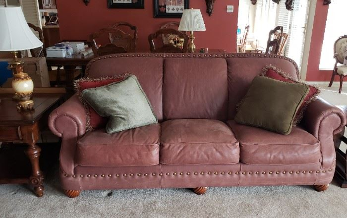Three cushion brown leather sofa
