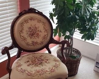 Upholstered arm chair, silk plant
