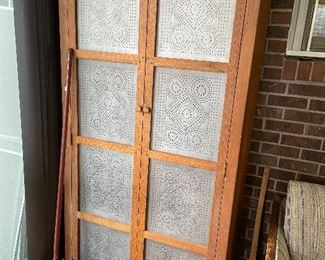 Incredible custom made cabinet with punched tin panels in door.