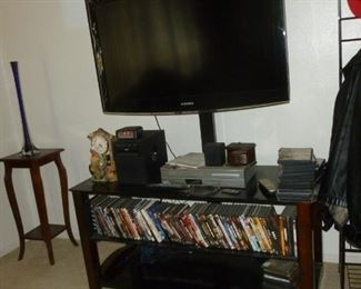 """40"""" Samsung on stand w/nice TV Stand..Lots of DVDs"""