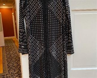 Luxurious, heavy jeweled coat by Michael Korrs size Medium with black sheath dress underneath $185