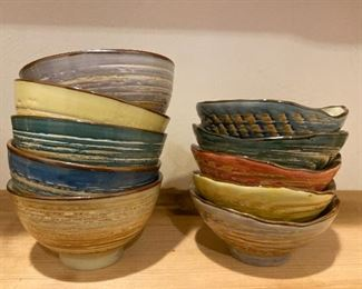 10 pottery bowls with various interior colors $45