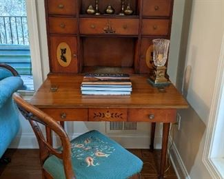 Vintage cherry wood writing desk, by Syracuse Furniture Co., matching chair, w/hand embroidered seat cushion.