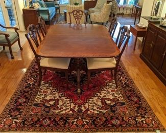 Vintage hand-woven Persian Heriz rug, Henredon banded mahogany dining table, with two leaves and table pads, set of eight chairs (pair of arms, 6 sides).