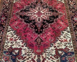 "Vintage Persian Heriz rug, measures 8"" 1"" x 10' 6""."