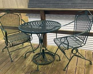Wrought iron patio set with 2 rocking chairs.