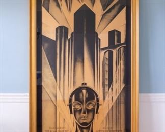 "Metropolis 1927 Fritz Lang 3 Sheet Movie Poster Lithograph S2.  Professionally framed artwork under mat board is larger than what is visible. Visible artwork measures 35 ⅝"" x 82 3/16"".  Frame measures  46""  x 92 1/4"". This Metropolis 3-sheet is a hand pulled lithograph of the original movie poster featuring image of False Maria."
