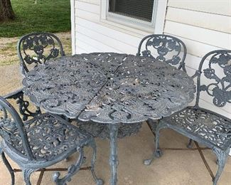 Iron patio table with four chairs