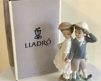 "Lladro Figurine; Children - measuring 10"" tall and includes the box.   Measures 6.75"" H x 9"" w."
