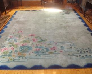 """Dining:  The vintage rug has a blue border and floral print.   It measures 9'   x   11'   5""""."""