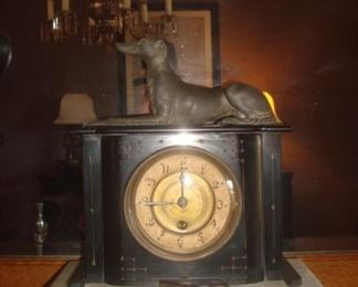 Dining Room:  The antique  clock has a black slate case but a white marble base.  The dog is iron.  (The clock key will be with the cashier.)