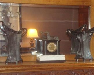 Dining Room:  A beautiful slate/marble mantel clock with a dog figure rests quietly between a pair of Art Deco-style vases that were purchased at a local art fair.  (A closer photo of the clock follows.)