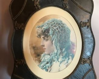 Dining Room: A print of girl in a blue scarf is in a fancy antique frame.