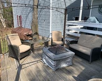 Patio furniture: 2 chairs, loveseat and coffee table.  Grill not available.
