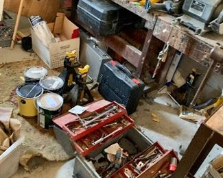 Garage filled with tools.... We are busy setting them all up for you.
