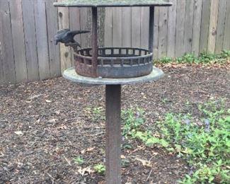 Bird feeder on stand.