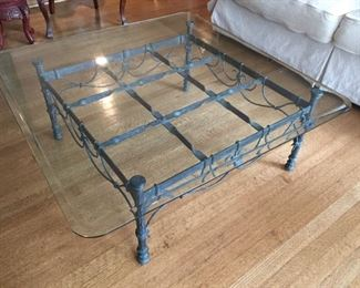 Iron coffee table with glass top.