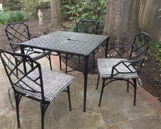 Four-piece wrought iron set with cushions.