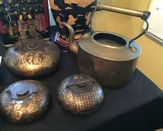 Asian style metal pieces.