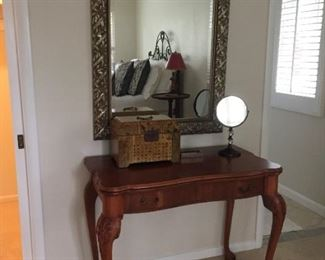 Large mirror and side table.