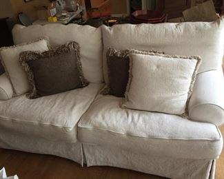 White Paul Robert Sofa with pillows.