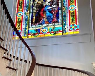 Exceptional European stained glass window, installed by Nicholas Cage during his ownership of the home. The three-paneled window depicts an angel playing the harp.Check back for measurements. See bottom of the ad for removal details.