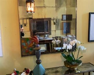 """Custom """"vintage"""" mirror, iron console with matching mirrored top; Carnevale masks, Sue Papa ceramic sculpture"""