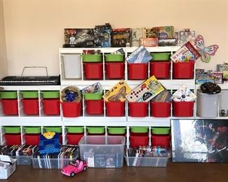 Lots of IKEA storage system units and matching bins, various games, DVDs, blu rays, CDs, Wii console, games and accessories