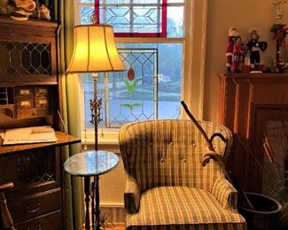 Fine upholstered sitting chair, marble base lamp with dual lights, leaded hanging glass window panels and early 1900 leaded glass secretary.