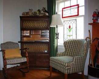 Antique rocking chair, 1 of 2 upholstered sitting chair, marble base lamp with dual lights, leaded hanging glass window panels, antique canes and early 1900 leaded glass secretary.