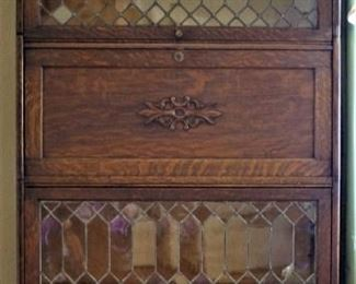 Oak GRM leaded glass secretary. No broken glass and all drawers opens and close. Keyed access to secretary section.
