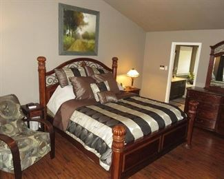 California King Headboard Cherry Wood with iron accents, foot board, comforter, pillows.  King Mattress and Spring NOT included.