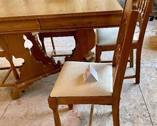 """Lot 7594. $350.00. Beautiful Antique Table and Chairs. This table is small but includes two leaves. The base is incredible and the chairs are sweet.  This table was in the homeowners family since it was made, it is stamped 2/23/1934. Was at one time white and the homeowners had it stripped to its original wood. STUNNING. Table measures: 45""""l x 32""""w x 30""""h with two 9"""" leaves.  4 chairs: 16""""w x 36"""" to back x 16.5""""deep and 13""""h to seat."""
