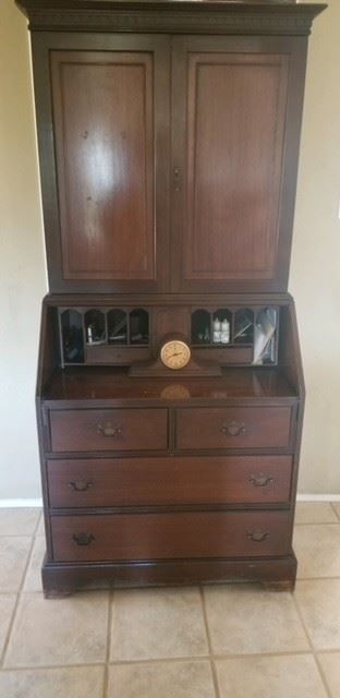 Antique Classic Secretary Desk opens with shelving and drawers below.  Items on desk not for sale $625