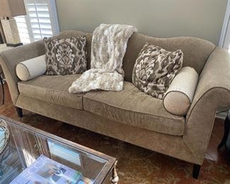 Tan upholstered sofa from Candice Olsen