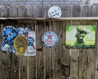 A variety of metal beer signs!