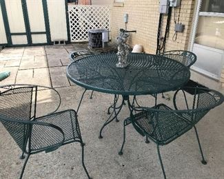 Wrought iron outdoor table with 4 chairs